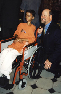 Michael F. Guilford and wheelchair-bound person.